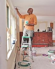 Dale Bridgewater of NorthEast Remodeling LLC works at 882 O'Brien Ave. in Rotterdam. The house is under renovation for Signature Home Buyers.