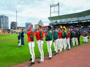 The 2014 Greensboro Grasshoppers during the singing of the national anthem before a home game at NewBridge Bank ballpark.