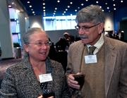 Dr. Lisa Filipovich and Marc Hult visit during the reception.