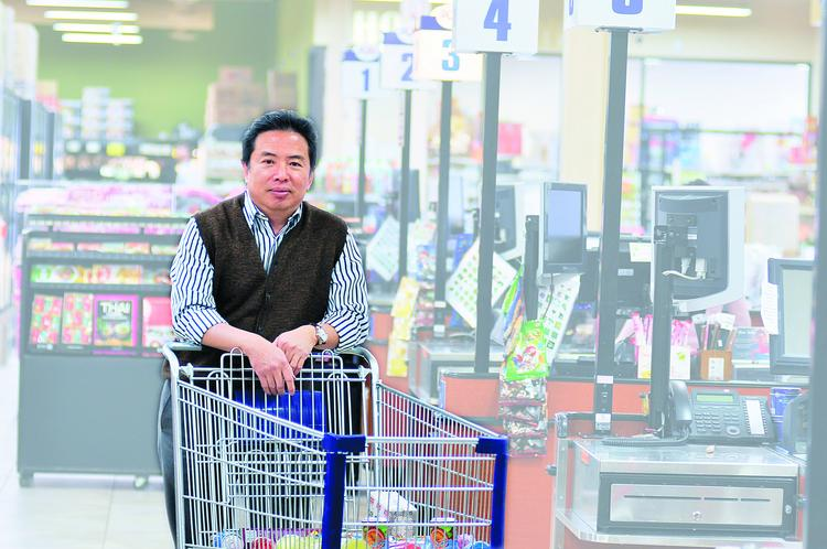 Trong Lam, owner of Pacific Ocean Marketplace, in the Denver store off of West Alameda Avenue near South Tejon Street. He has a Broomfield store as well as one slated to open in Aurora later this year using a small business loan from Chase Bank.