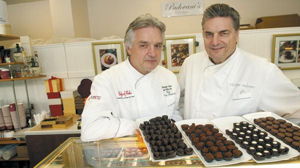 Pierre, left, and Philippe Padovani have traded in their careers in the restaurant business to concentrate on making and selling chocolates. Philippe says he has not ruled out getting back into the restaurant business, but probably not in Hawaii, which he contends is too expensive.