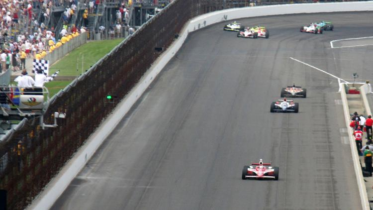 Scott Dixon from New Zealand nears the finish line during the Indianapolis 500 race at the Indianapolis Motor Speedway in Indianapolis in 2008.