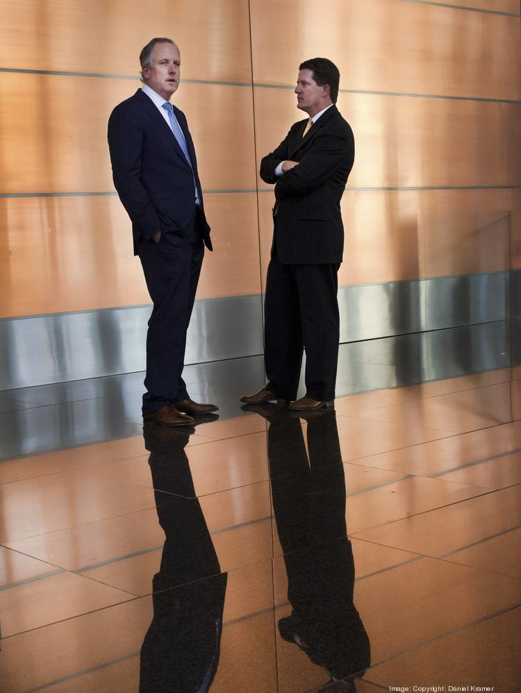 Chip Colvill, left, and Mark O'Donnell in the lobby at CityWestPlace Building 2, which was part of Statoil's massive lease the duo worked on for two years.