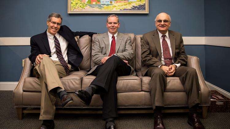 From left, Drs. Robert Smithson, Todd Helton and Charles Wehbie now run Boylan Clinic