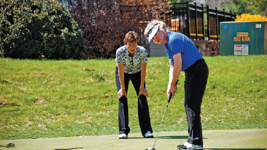 Vikki Chandley, left, coaches Rachel George at the Nashville Golf & Athletic Club in Brentwood.