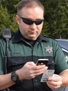 """Intellicheck Mobilisa's new """"Fugitive Finder"""" app allows police to check a driver's license to see if the driver is a fugitive."""