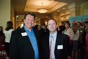 Keith Knell, left, of The Provident Group, with Kurt Barton, of Tractor Supply Co.