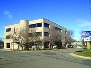 Paster Enterprises and Bader Development have submitted a concept plan with the city to build a six-story apartment and retail building at the site of the Highland Bank office building (shown here) near Ridgedale Center.