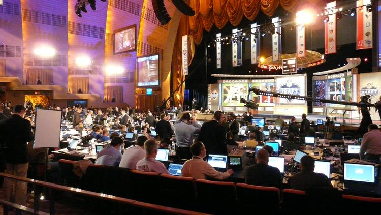 Media and NFL team staffers gaze at their laptops during the 2010 NFL draft at Radio City Music Hall, in New York City.