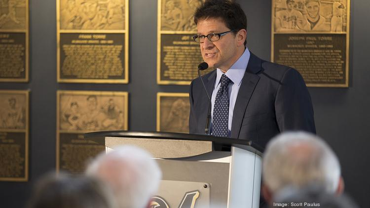 Brewers principal owner Mark Attanasio spoke at the CFA Society of Milwaukee luncheon Friday.