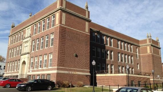 The proposal to fill the vacant Gate of Heaven School in South Boston with luxury condos has sparked opposition in the neighborhood.