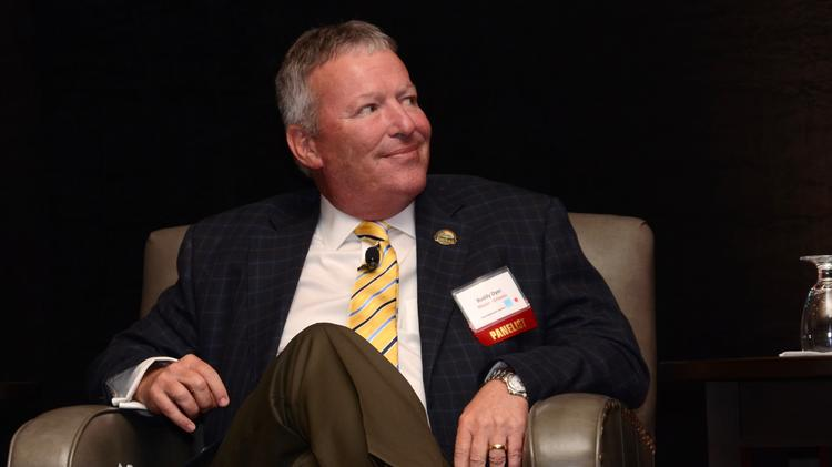 As usual, Mayor Buddy Dyer sports the most awesome socks in the room during Orlando Business Journal's Meet The Mayors event May 9. The city will consider a proposal May 12 to help boost Orlando's tech industry.