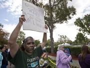 Several hundred protesters chanted and held signs during Obama's visit to a Wal-Mart in Mountain View on Friday.