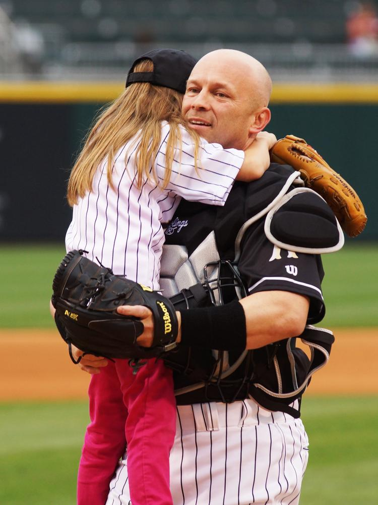 Charlotte resident Philip Elmore, stationed in Germany for his service in the Navy, surprised his 8-year-old daughter at BB&T Ballpark on Friday.