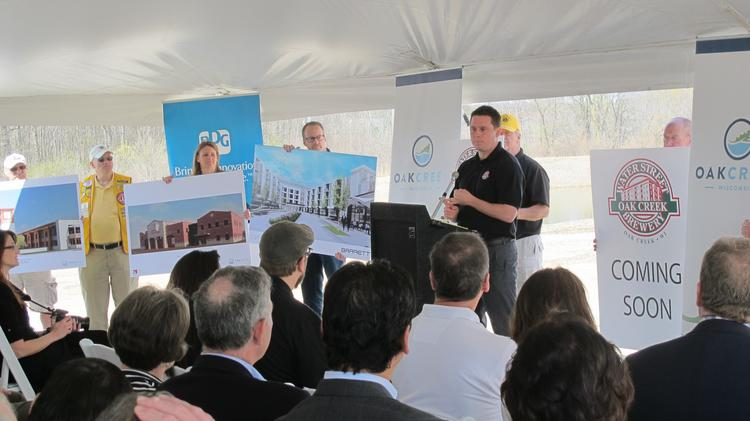 Matt Schmidt, Water Street Brewery director of operations, announces the new restaurant and brewery location.