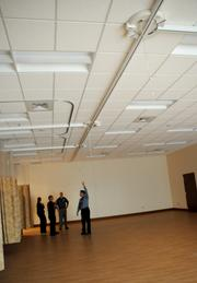 An expansive rehab center is also equipped with lift tracks for immobile patients.