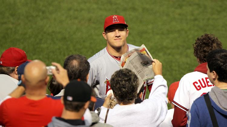 Local pro Mike Trout signs autographs. The Anaheim Angels star outfielder is set to make his first appearance in Philadelphia on Tuesday.