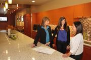 Tierney Siler, center, went to work for Blach Construction, instead of a tech company. She was won over by management and company culture as an intern. Gaye Landau-Leonard, left, Siler and Cassie Camilleri converse in the company kitchen.