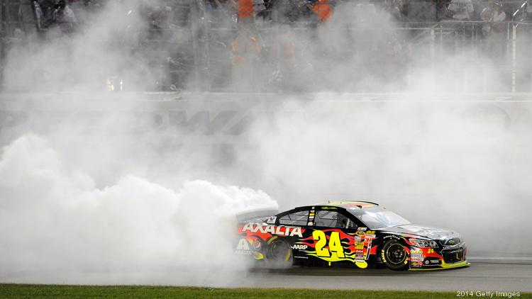 Jeff Gordon celebrates with a burnout after winning the NASCAR Sprint Cup Series race at Kansas Speedway on Saturday night. The race led the local sports TV ratings for the weekend but trailed the first round of the NFL Draft.