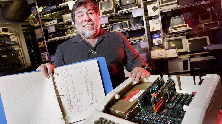 Steve Wozniak, co-founder of Apple Inc. shows a 150-page notebook with his handwritten code for the Apple II computer at the Computer History Museum in Mountain View, Calif., in 2007.