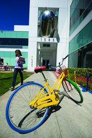 Google Plus: In many ways, the Googleplex resembles a private college. People ride shuttles to campus, eat in cafeterias, and ride bikes from building to building. The campus' public areas are relatively open to curious tourists, much like college. Google lavishes perks on its employees partly out of necessity and partly because it can. In 2012, Google pulled in about $900,000 in annual revenue per employee. That lets the company push the envelope on benefits.