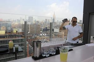 A bartender shakes a drink on the rooftop bar of the Standard Hotel where Jay Z's sister-in-law Solange Knowles reportedly physically attacked him in an elevator.