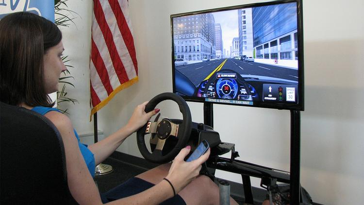 I got behind the wheel of AT&T's texting while driving simulator. My joy ride ended quickly after I ran a stoplight while checking my text messages.