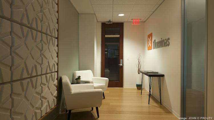 The small Iluminas reception area is big on style with contemporary furniture and unconventional wall treatments.
