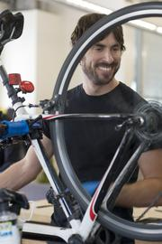 Spinning wheels: Bike mechanic Shea Mack fixes an employee's road bike at Facebook's full-service, onsite bike repair shop. Mack and the rest of the team spend their days tuning up the company's communal beach cruisers and bikes owned by individual Facebook employees.