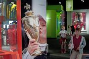 A picture of Calvin Borel kissing the trophy after winning the 2009 Kentucky Derby is part of a display at the Derby Museum.