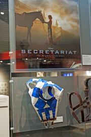 "The museum includes a display for Secretariat showing the blinkers he wore when racing. It's been 40 years since Secretariat's historic Triple Crown triumph, and the Derby Museum is giving Thoroughbred racing's most celebrated athlete a proper tribute. A temporary exhibit that showcases the horse includes rare artifacts from Secretariat's era and props from the 2010 Walt Disney Pictures movie about his life. On Wednesday, May 1, at 6 p.m., the Derby Museum will celebrate the 40th anniversary of Secretariat's Triple Crown with a sold-out event attended by his owner, Penny Chenery, and jockey, Ron Turcotte. Museum executive director Lynn Ashton called Chenery, who is in her 90s, ""truly the grand lady of racing."" ""You've never met anybody any nicer or any more accommodating than she is."""