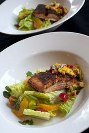 Blackened Salmon with Mango Salsa, shown here, is the dish that will be prepared by Upper Crust Catering for the Barnstable Brown Derby Eve Gala. ____________________________________________      By the numbers Upper Crust Catering LLC executive chef Tracy Popp expects to cook more than 1,500 pounds of food for the Barnstable Brown Gala. Most of it will be prepared off site and delivered to the party. Here's what they plan to serve: 300 pounds: beef tenderloin 200 pounds: pork loin 200 pounds: salmon  250 pounds: chicken 250 pounds: mashed potatoes 300 pounds: mixed vegetables  Also, Upper Crust expects to serve 3,000 pieces of dessert. One option will be mint julep cheesecake.