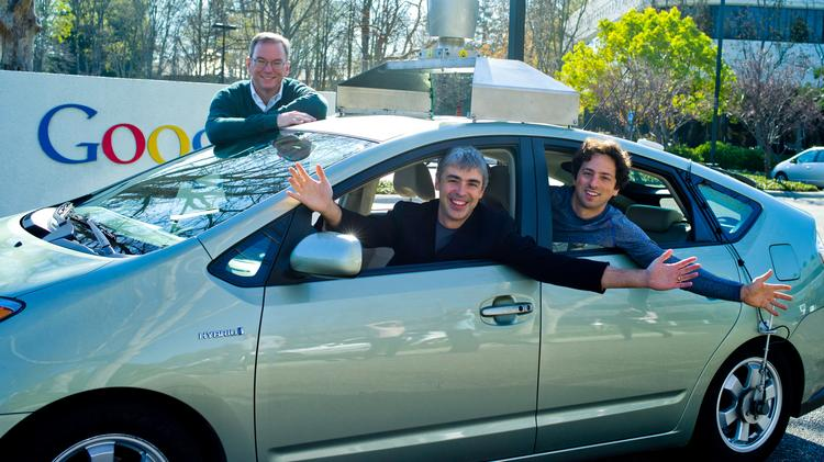 Google Chairman Eric Schmidt, with CEO Larry Page and co-founder Sergey Brin in a self-driving car.