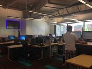 The data center team has large screens around the office with customer information. This team was particularly happy with the move because the new office has natural light. They had been in a windowless office since 2006. Throughout the office employees were allowed to choose stand up or sit down desks.