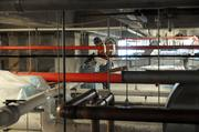 Workers can access machinery in between floors inside the VA Hospital.