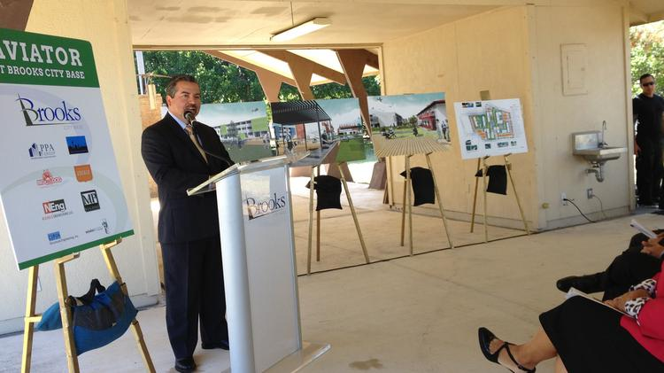 File photo of BDA President and CEO Leo Gomez talking about the Aviator at Brooks City Base — a multifamily community poised to spur more interest and investment in the former Air Force Base.