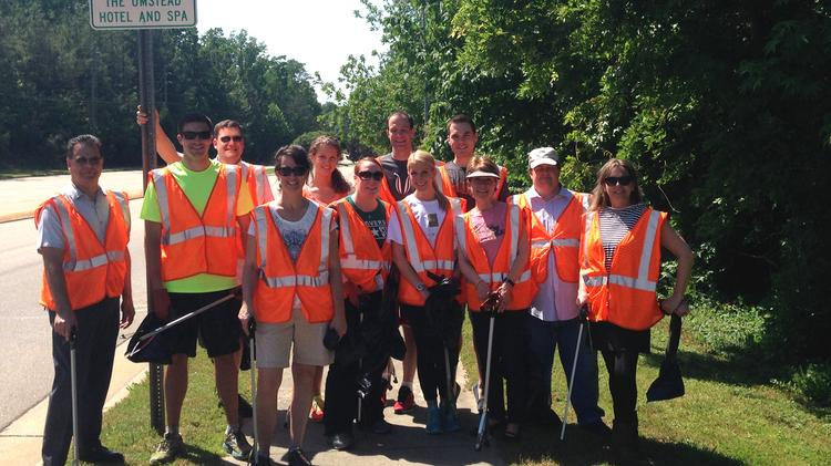 Staff from the Umstead Hotel & Spa helped clean up its adopted stretch of highway.