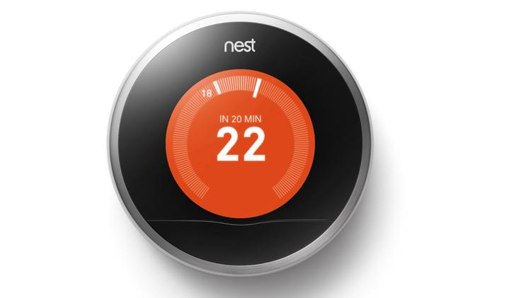 The Nest Learning Thermostat adapts based on its users' energy use and can be controlled by a smartphone.