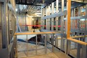 Counters are being constructed in a full-service pharmacy where patients can pick up their medication on-site.
