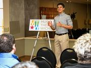 Trevor McChristian preforms a selection from Joseph and the Amazing Technicolor Dreamcoat during Music Theatre Wichita's unveiling of its new logo design Thursday morning at Century II.