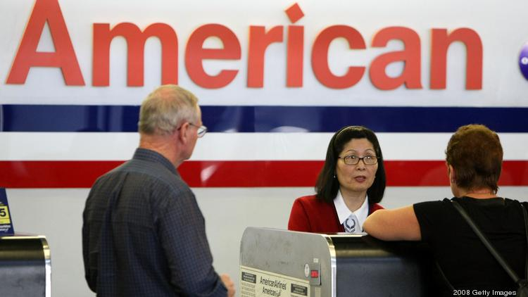 An American Airlines ticket agent helps customers check in for flights at San Francisco International Airport.