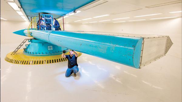 The Heaviest: Hydraulic motors at the Centrifuge Test Complex spin components so fast that they can experience up to 300gs, or 300 times their weight. The tests measure how well components can resist the pressure of acceleration, deceleration or a rocket launch. Here, Glenn Yarborough inspects the centrifuge arm while Orlando Abeyta (left) and Ed Romero (right) work above.