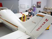GTCC avionics technology students Logan Robinson (seated) and Rita Freeman (standing in the background) are testing the transponder on this small plane.