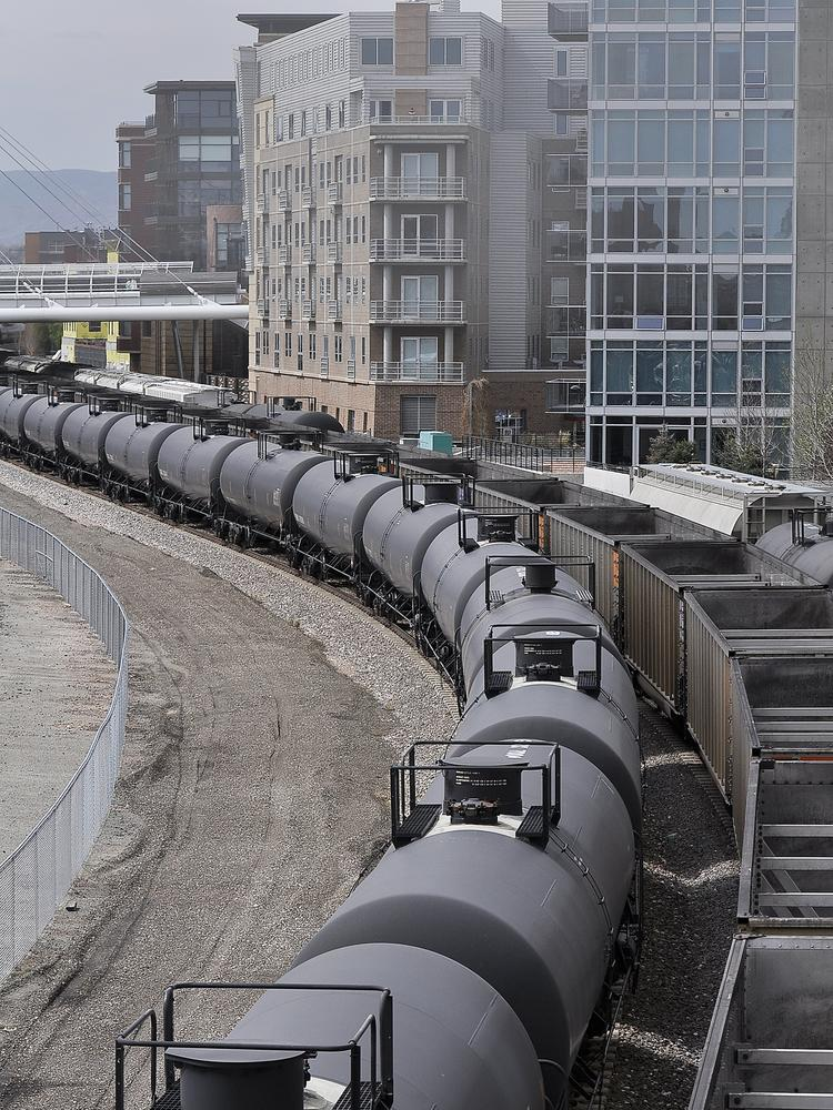 Oil tankers make their way through Denver recently.