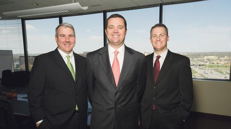 Larkin O'Keefe (center), CEO of MedTrak Services, is flanked by CIO Scott Holland (left) and COO Mark Fendler.