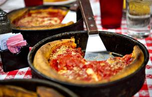 Deep dish pizza sits on a table at Gino's East restaurant in Chicago.