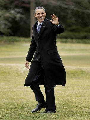 President Barack Obama waves as he leaves White House Tuesday to give a speech about sequestration's negative impact at a shipyard in Newport News, Va.