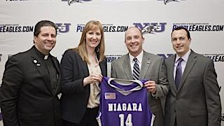 Simon Gray, third from left, is the new athletic director at Niagara University. From right to left, he is joined by the Rev. James Maher, C.M., president, Kendra Faustin, head coach of women's basketball, and Chris Casey, head coach of men's basketball.