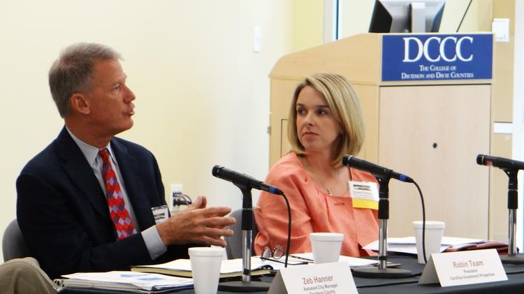 Robin Team, left, president of Carolina Investment Properties, talks about the development of a new industrial park while Camey Thomason with Wake Forest Baptist's Lexington Medical Center looks on during the Triad Business Journal's 2014 State of Davidson event.