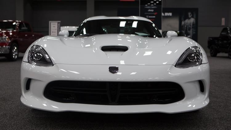The 2014 Dodge Viper SRT, seen here in all white, is one of the new, sportier models on display at the Austin Convention Center. Click on the image to launch a slideshow of photos from event.